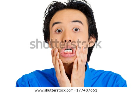 Closeup portrait of unhappy, upset, sad thoughtful young business man thinking deeply, bothered by mistakes, hands on face and cheeks, isolated on white background. Negative emotion facial expressions - stock photo