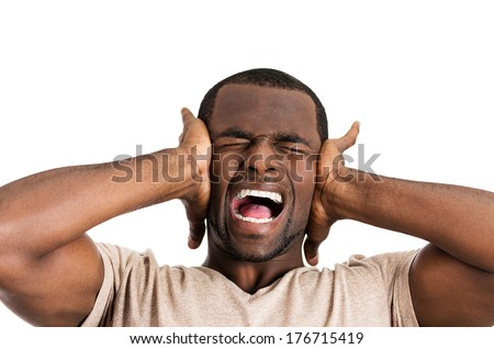 Closeup portrait of upset, frustrated, overwhelmed, stressed young man squeezing his head, going nuts, screaming, losing mind, isolated on white background. Negative emotion facial expression feelings - stock photo