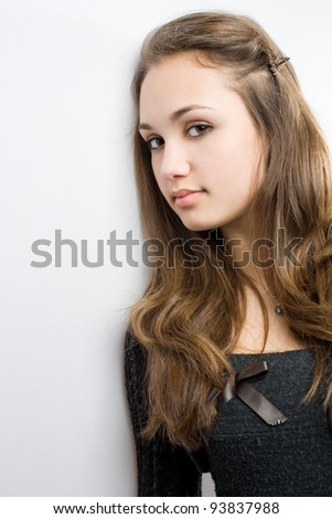 Closeup portrait of very cute young brunette with copy space. - stock photo