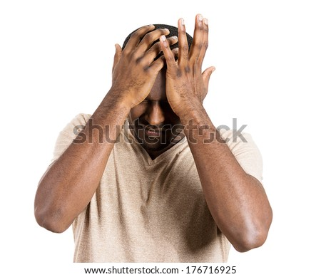 Closeup portrait of very sad depressed, stressed, alone, disappointed gloomy young man resting his head on hands, having suicidal thoughts isolated on white background. Human emotion facial expression - stock photo