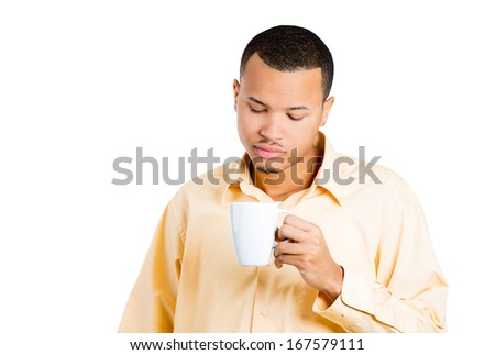Closeup portrait of very tired, falling asleep,  businessman, student holding cup of coffee, struggling not to crash, stay awake, keeping his eyes opened, isolated on white background. Face expression - stock photo