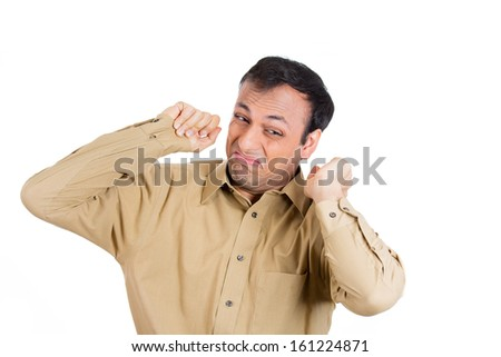 Closeup portrait of whiny guy in brown shirt about to cry and have a temper tantrum, isolated on white background. Negative human emotion facial expressions - stock photo