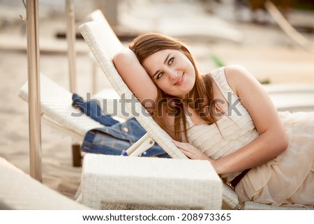 Closeup portrait of woman in dress relaxing on sunbed