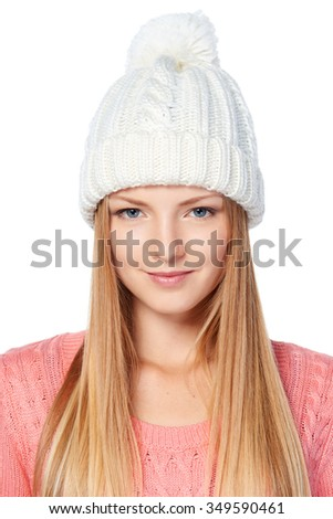 Closeup portrait of woman on white background wearing woolen hat and sweater - stock photo