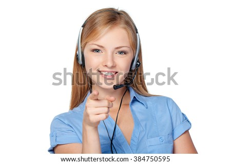 Closeup portrait of woman support phone operator in headset smiling pointing at camera - stock photo