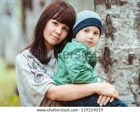 closeup portrait of woman with son, happy family - stock photo