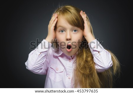 Closeup Portrait of wondering girl going surprise on gray background - stock photo