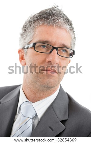 Closeup portrait of worried businessman wearing gray suit with blue tie and glasses. Isolated on white background.