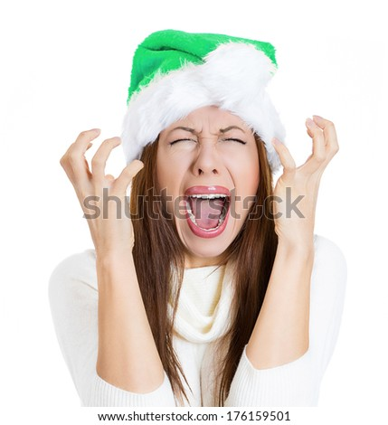 Closeup portrait of worried stressed overwhelmed young woman, funny looking girl wearing green hat, screaming going crazy, isolated on white background. Human emotions, facial expressions, reaction. - stock photo