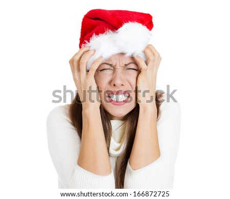 Closeup portrait of worried stressed overwhelmed young woman wearing red santa claus hat, screaming going crazy, isolated on white background. Emotion facial expression. Last minute christmas shopping - stock photo