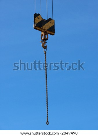 closeup portrait of yellow crane in blue sky