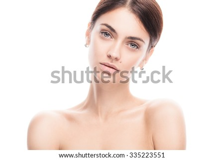 closeup portrait of young adult woman with clean fresh skin isolated on white - stock photo