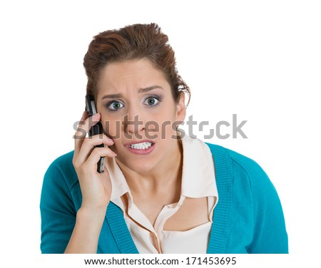 Closeup portrait of young angry business woman, corporate employee, student talking on a cell phone, having unpleasant conversation, isolated on white background. Negative emotion facial expression - stock photo