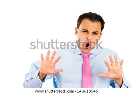 Closeup portrait of young, angry man gesturing no with hands and saying no with his mouth, isolate on white background copy space on left - stock photo