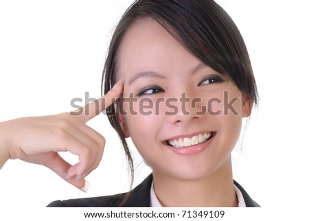 Closeup portrait of young Asian lady put finger on head. - stock photo