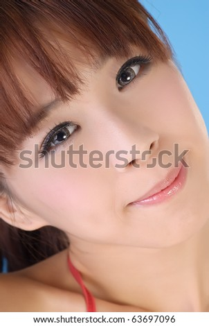 Closeup portrait of young attractive and beautiful Asian woman. - stock photo