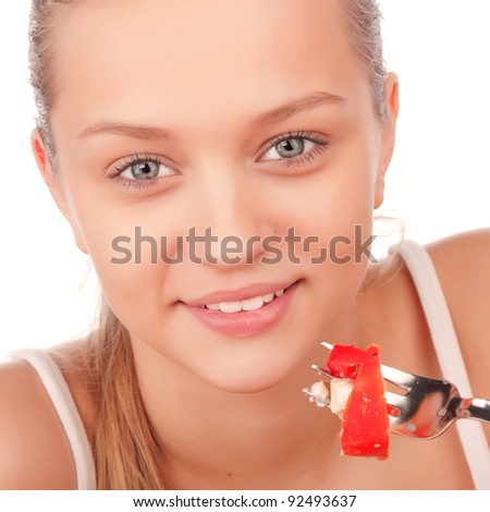 closeup portrait of young attractive smiling caucasian woman eat vegetarian tomato and paprika salad, beauty young girl eating vegetable salad, attractive woman with plate of salad,isolated on white - stock photo