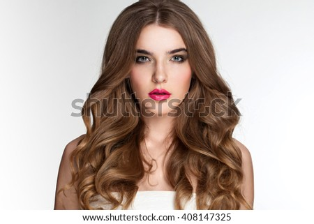 Closeup portrait of young beautiful blond girl with curly hair on white background. - stock photo