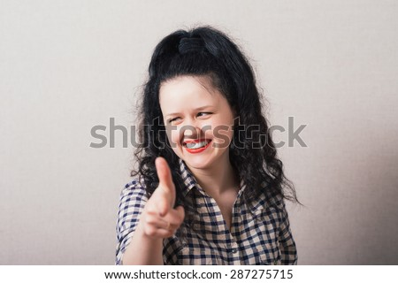 Closeup portrait of young, beautiful, excited, happy woman smiling, laughing, pointing finger towards you, camera gesture. Positive human emotion, attitude, reactions - stock photo