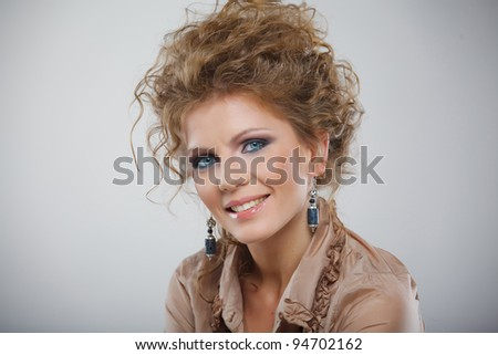 Closeup portrait of young beautiful girl with makeup