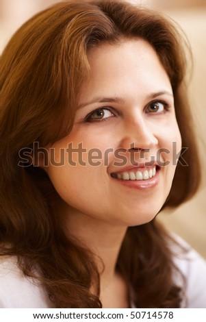 closeup portrait of young beautiful woman indoor - stock photo