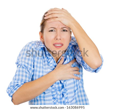 Closeup portrait of young beautiful woman scared, afraid, shocked, terrified of unexpected impact, insult holding her head isolated on white background. Negative human emotions and facial expressions. - stock photo