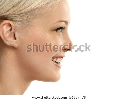 Closeup portrait of young beautiful woman smiling in profile - stock photo