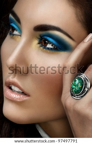 Closeup portrait of young beautiful woman with bright fashion makeup - stock photo
