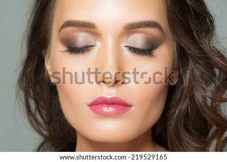 Closeup portrait of young beautiful woman with stylish smoky eyes makeup  - stock photo