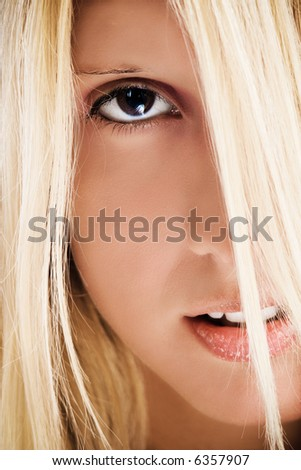 closeup portrait of young blond woman - stock photo