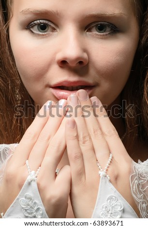 closeup portrait of young bride in wedding expectation - stock photo