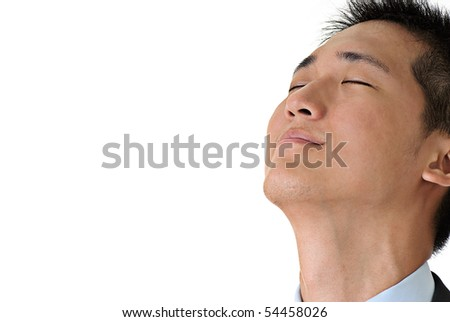 Closeup portrait of young business executive of Asian feeling good and relaxing against white with copyspace. - stock photo