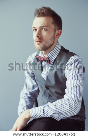Closeup portrait of young business man in waistcoat - stock photo