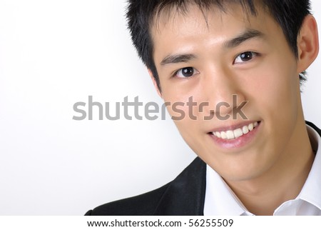Closeup portrait of young business man of Asian with copyspace on white. - stock photo