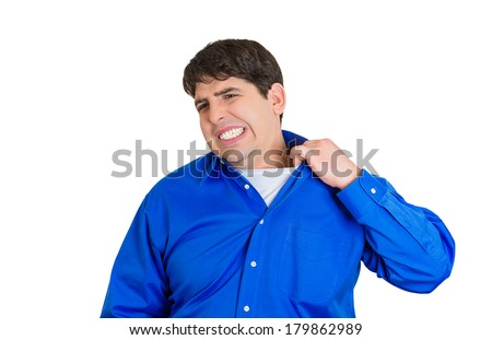 Closeup portrait of young business man opening shirt to vent, it's hot, unpleasant, awkward situation, embarrassment. Isolated on white background. Negative human emotions, facial expression, feelings - stock photo