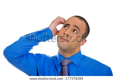 Closeup portrait of young business man scratching head thinking daydreaming deeply about something looking up isolated on white background. Human facial expressions, emotions, feelings, signs, symbols - stock photo
