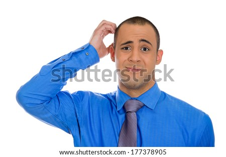Closeup portrait of young business man scratching head thinking daydreaming deeply about something looking at you isolated on white background. Human facial expression emotion, feelings, sign, symbols - stock photo