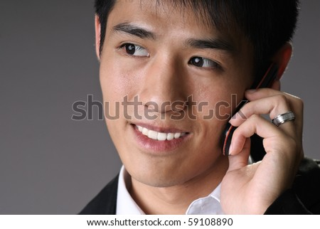 Closeup portrait of young business man use cellphone with copyspace.