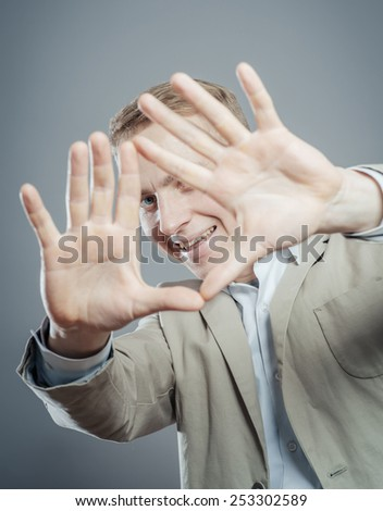 Closeup portrait of young businessman covering his face with hand - stock photo