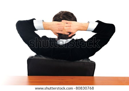 Closeup portrait of young businessman from the back. Sitting with opened arms on his armchair. Isolated over white background - stock photo