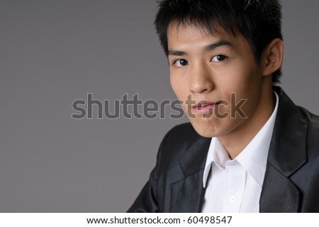 Closeup portrait of young businessman of Asian with confident expression. - stock photo