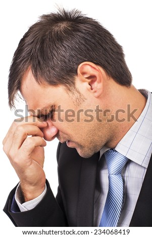 Closeup portrait of young businessman with strong headache isolated on white background - stock photo