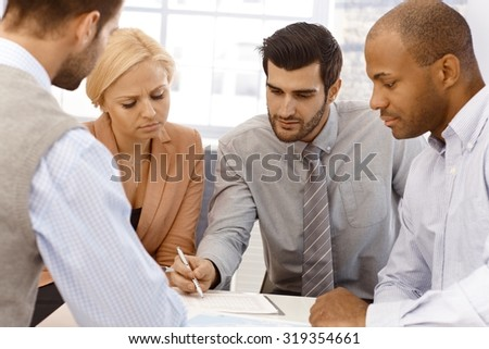 Closeup portrait of young businessteam working together. - stock photo
