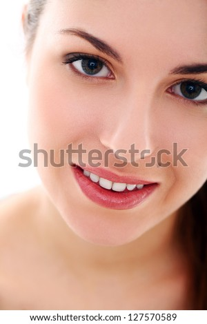 Closeup portrait of young caucasian woman isolated over background