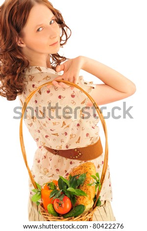 Closeup portrait of young caucasian woman with straw basket of fresh vegetables wearing trendy clothes isolated on white background