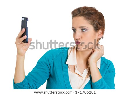 Closeup portrait of young cocky beautiful woman looking admiring her face and hair in front of phone camera, isolated on white background. Negative human emotions, facial expressions, feelings. - stock photo