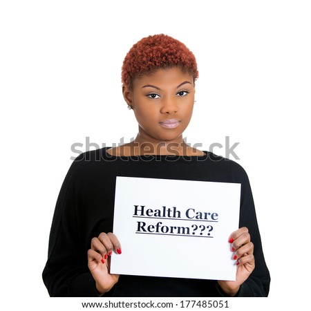 Closeup portrait of young confused, sad worker, skeptical woman holding sign health care reform, uncertain of universal insurance coverage isolated on white background. Government politics legislation - stock photo