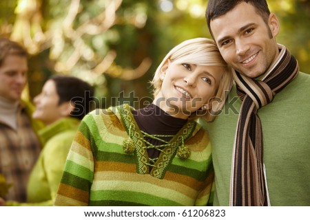 Closeup portrait of young couple embracing in autumn park.? - stock photo