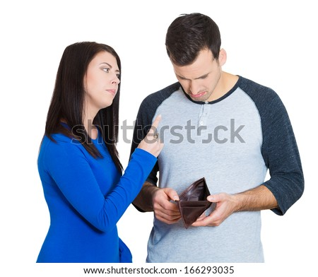Closeup portrait of young couple. Handsome man holding empty wallet, feels guilty for reckless spending, woman mad about it, isolated on a white background. Family budget, bad financial decisions - stock photo
