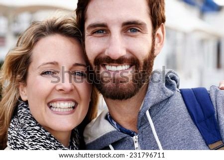 closeup portrait of young couple having fun smiling happy